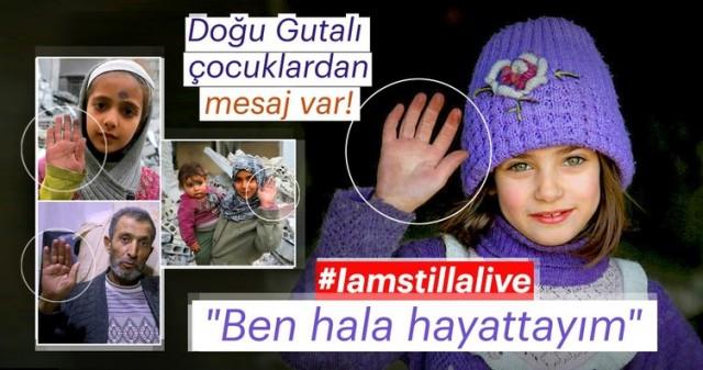 """Doğu Guta'da katliam tüm çağrılara rağmen devam ediyor. Doğu Guta'lı çocuklar, sosyal medyada başlattıkları """"Iamstillalive"""" (ben hala hayattayım) kampanyasıyla kendilerine yardım talebinde bulunuyor.  Beşşar Esed rejimi ve destekçilerinin son 12 günde 127 çocuğu katlettiği Doğu Guta'da çocuklar, """"ben hala hayattayım"""" etiketi ile sosyal medyada farkındalık kampanyası başlattı."""