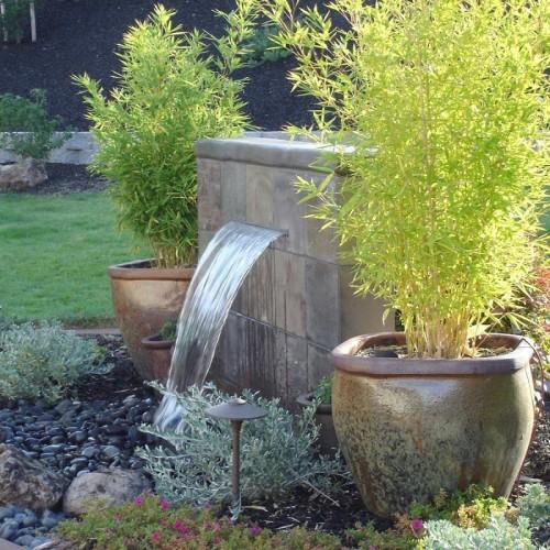 Evin bahçesine konan çeşmelerin farklı bir havası bulunuyor
