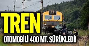 İsveç'te tren otomobili yüzlerce metre sürükledi