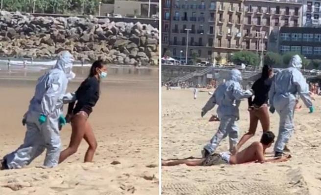 Covid-19 hastası olmasına rağmen denizde sörf yapan kadın tutuklandı