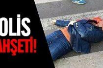Polis kırmızıda geçen kadını çekiçle yere serdi
