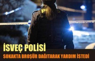 İsveç polisi, sokakta broşür dağıtarak yardım...