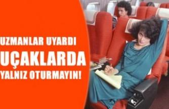 Uçaklarda yalnız oturmak tehlikeli