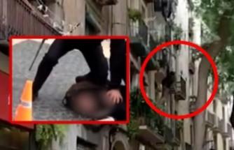 Üç cinayetten aranan İsveç vatandaşı polisten kaçmak için kendini balkondan attığı anlar kameraya böyle yansıdı